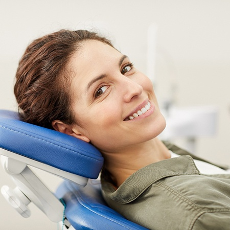 Woman smiling in dentist's treatment chair