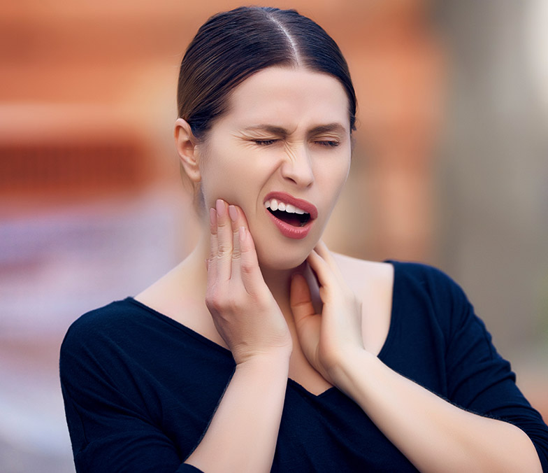 Woman's face contorting in pain from teeth