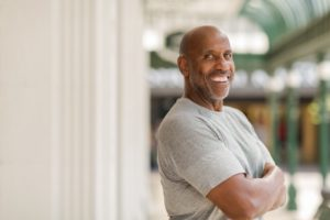Confident, healthy man with dental implants in Longview